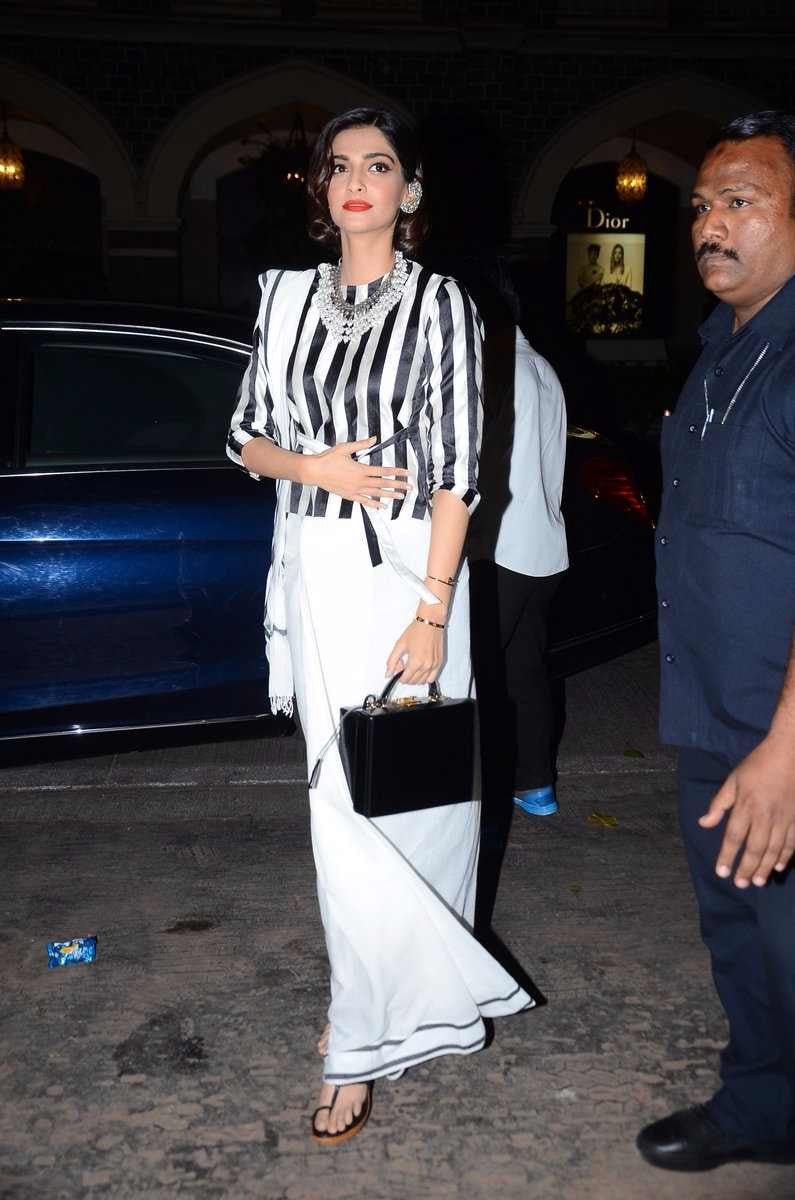 Sonam Kapoor attending the store launch at Mumbai Wearing a black and white striped long sleeved blouse from Raw Mango collection's saree in a Gujrati style drape