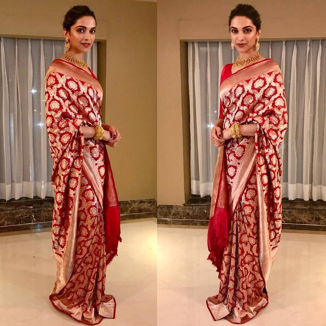Deepika Padukone looked like a bridal in beautiful red and gold banarasi silk saree from Sanjay Garg's label, Raw Mango.