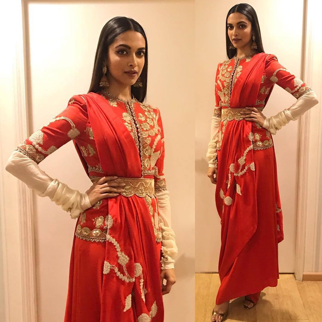 Deepika Padukone's bridal beauty look in bright red saree by Anamika Khanna