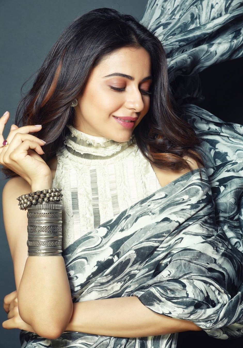 Rakul Preet Singh in Marbled-Effect Printed Saree from Limerick's Collection