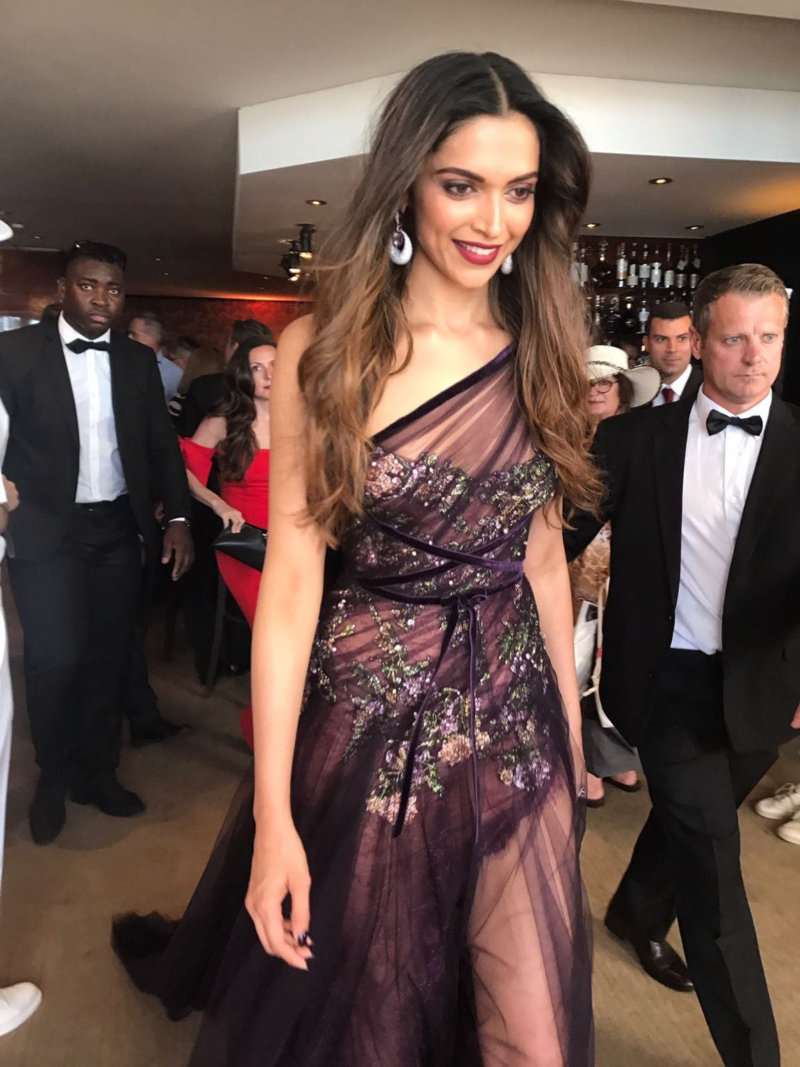 Deepika Padukone walked the red carpet for the Cannes Film Festival wore a sheer purple Marchesa outfit, and paired it with De Grisogono jewelry and Jimmy Choo heels