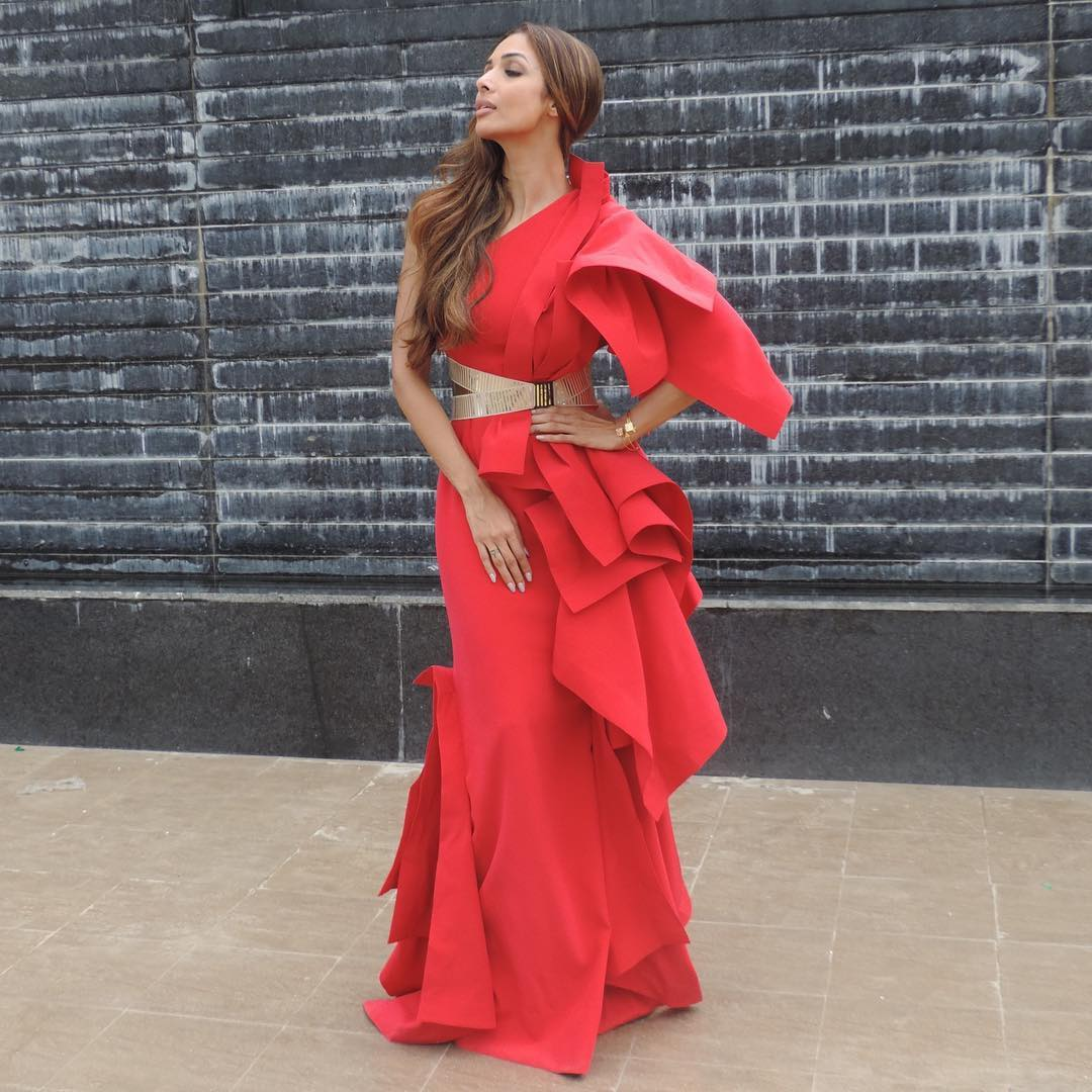 For the shoot of India's next Super model Malaika Arora wore a dramatic ruffled gown by Gaurav Gupta in a firey red hue