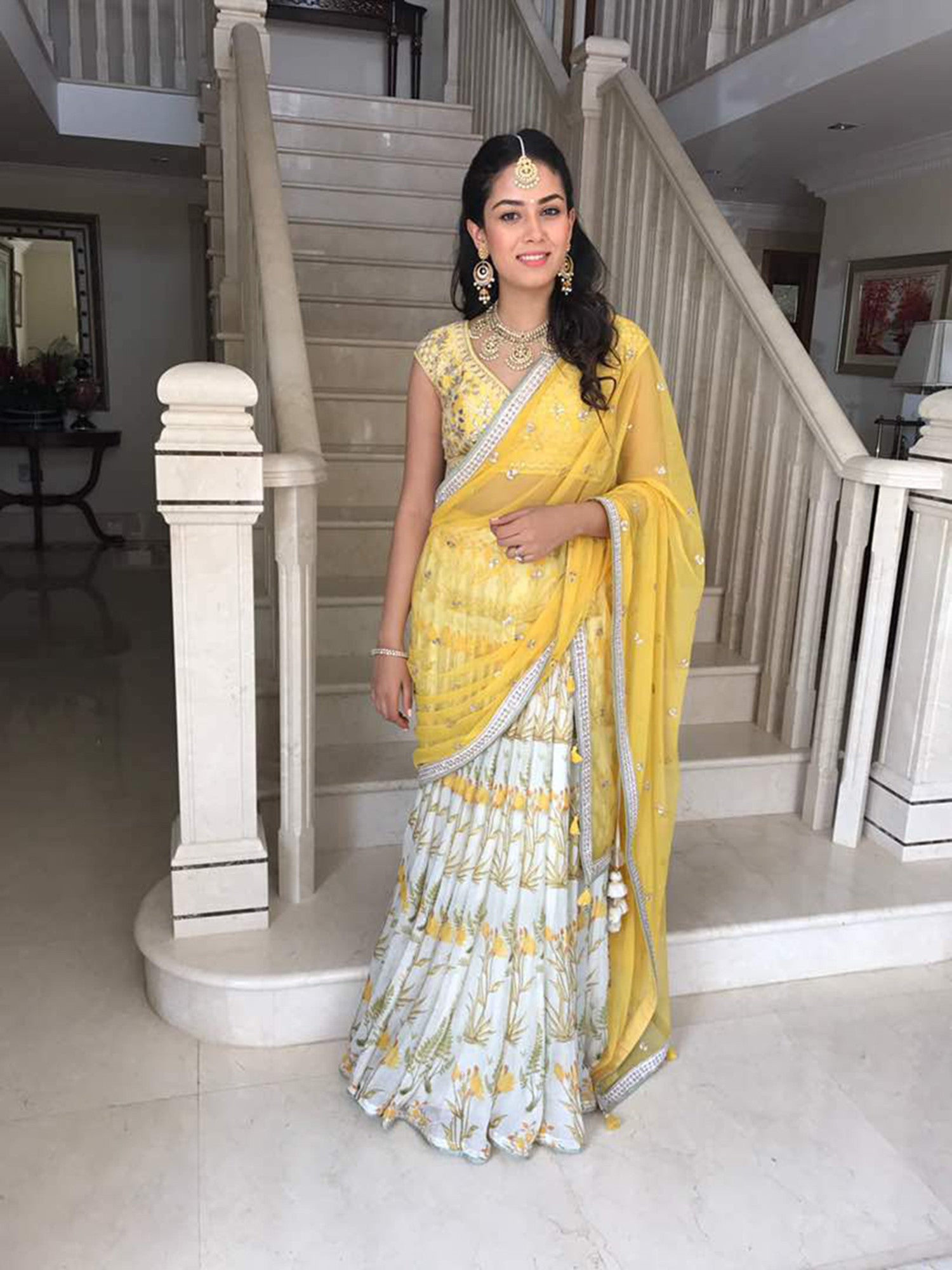 Mira Kapoor wearing an Anita Dongre lehenga and jewellery from Mahesh Notandass