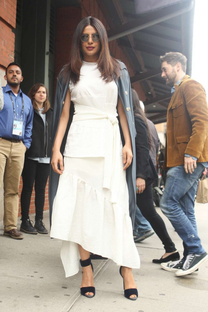Priyanka Chopra in white long frilled maxi dress team up with long coat