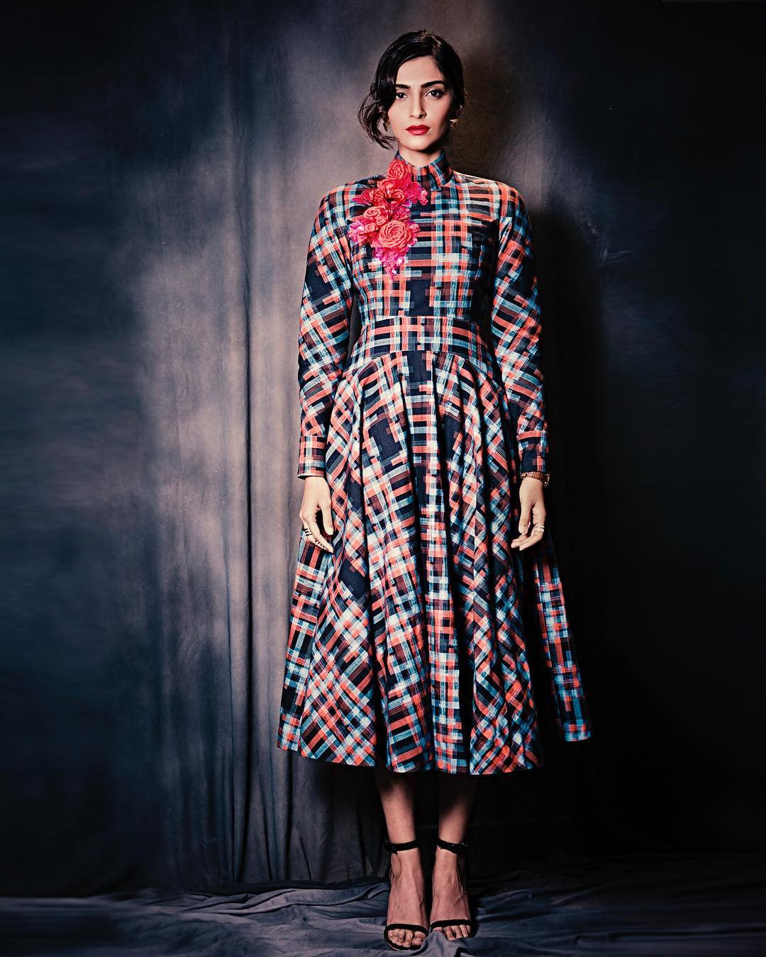 Sonam Kapoor picked out a beautiful red, blue and black checked midi from Delpozo's Pre-Fall 2017