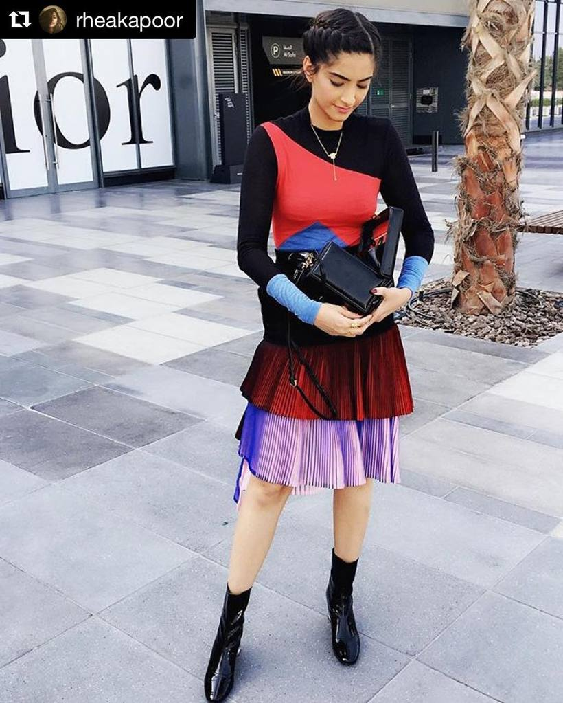 Sonam Kapoor In Black & red color block pattern top with two-toned pleated skirts
