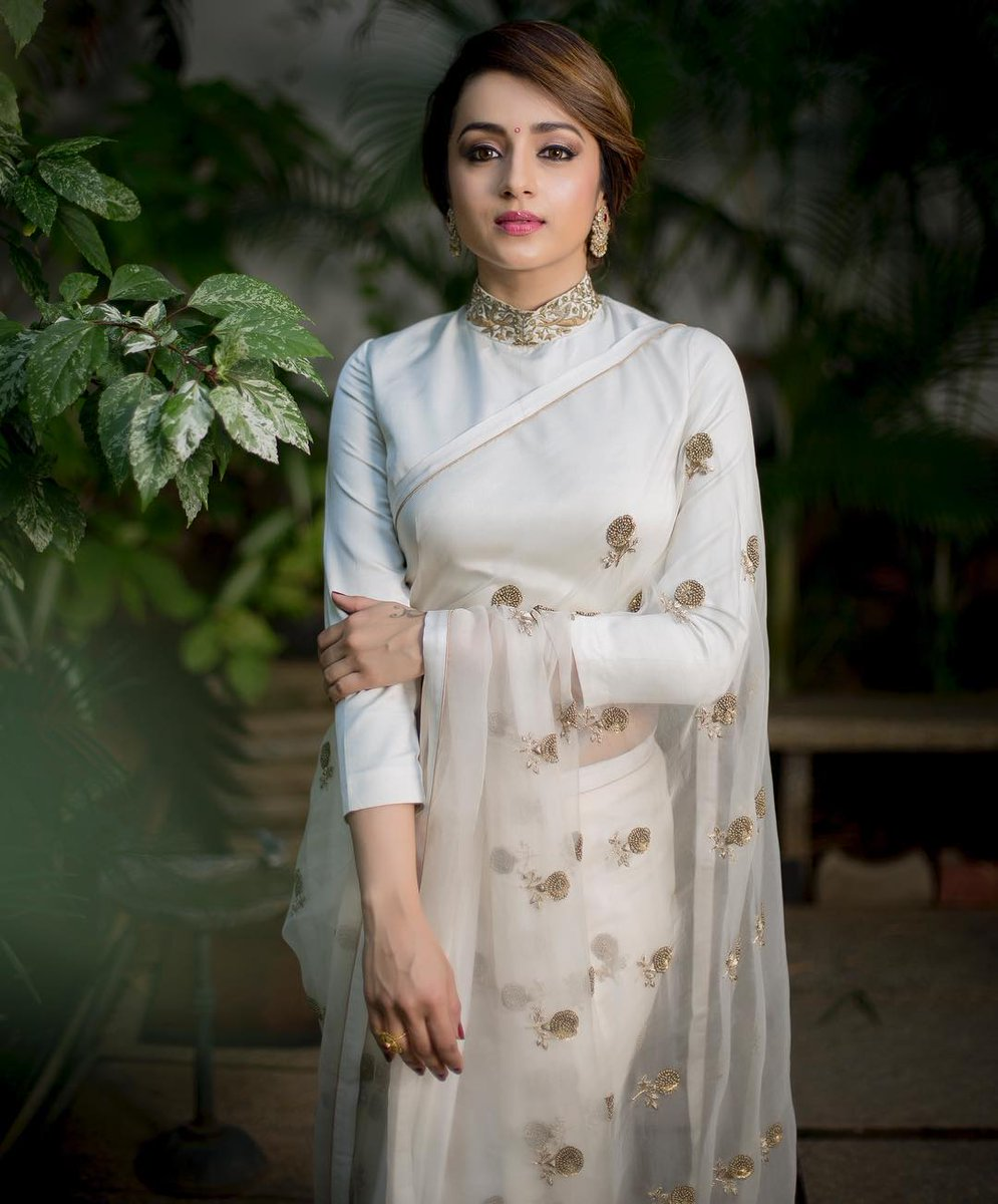 33499918f1 Trisha Krishnan attended the Hindu World Of Women Awards event wearing a  white saree with matching high neck full sleeved embroidered blouse by Raw  Mango.
