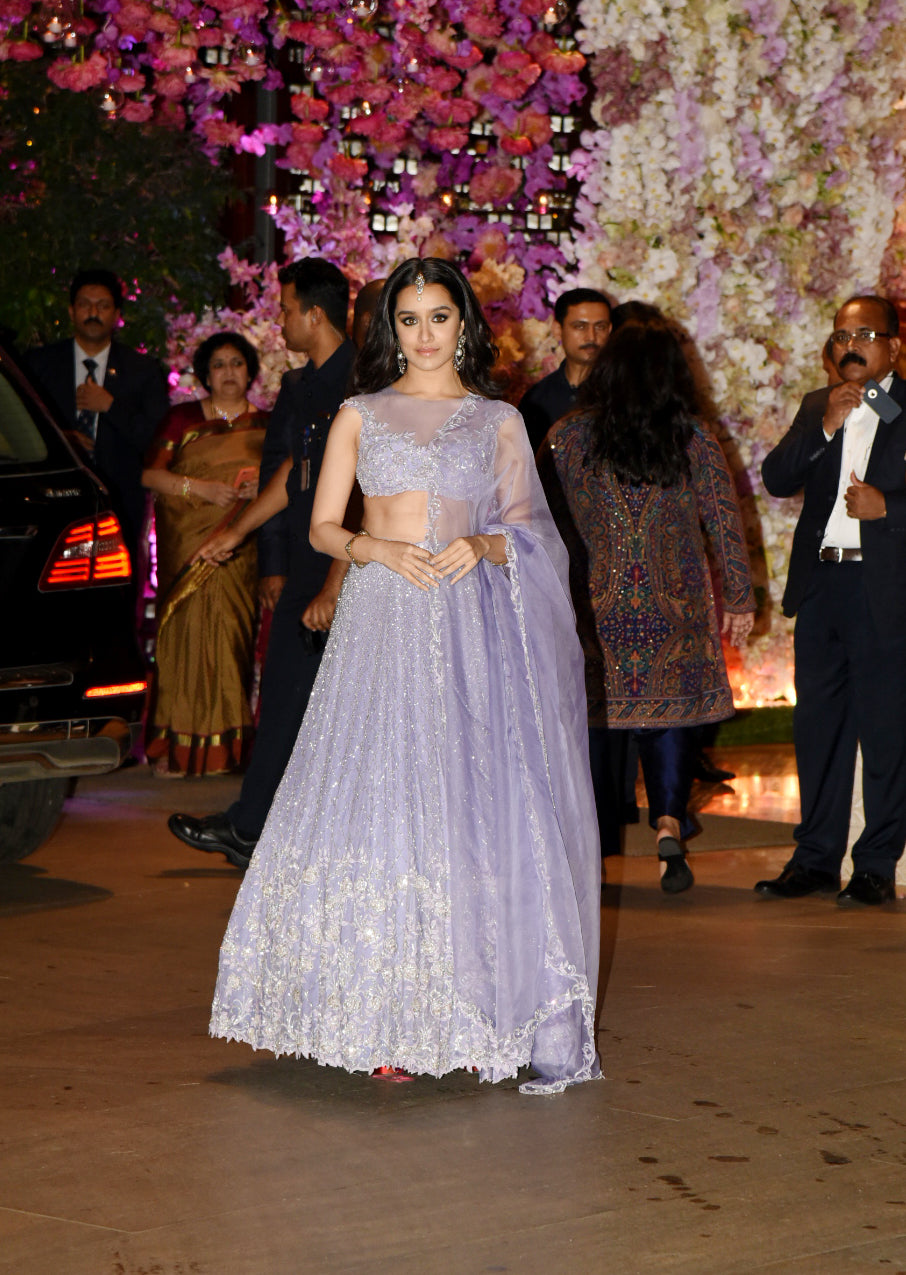 5e4133a6d29f0 At Akash Ambani and Shloka's engagement, Shraddha Kapoor was seen in a  lavender embroidered lehenga by Koecsh.