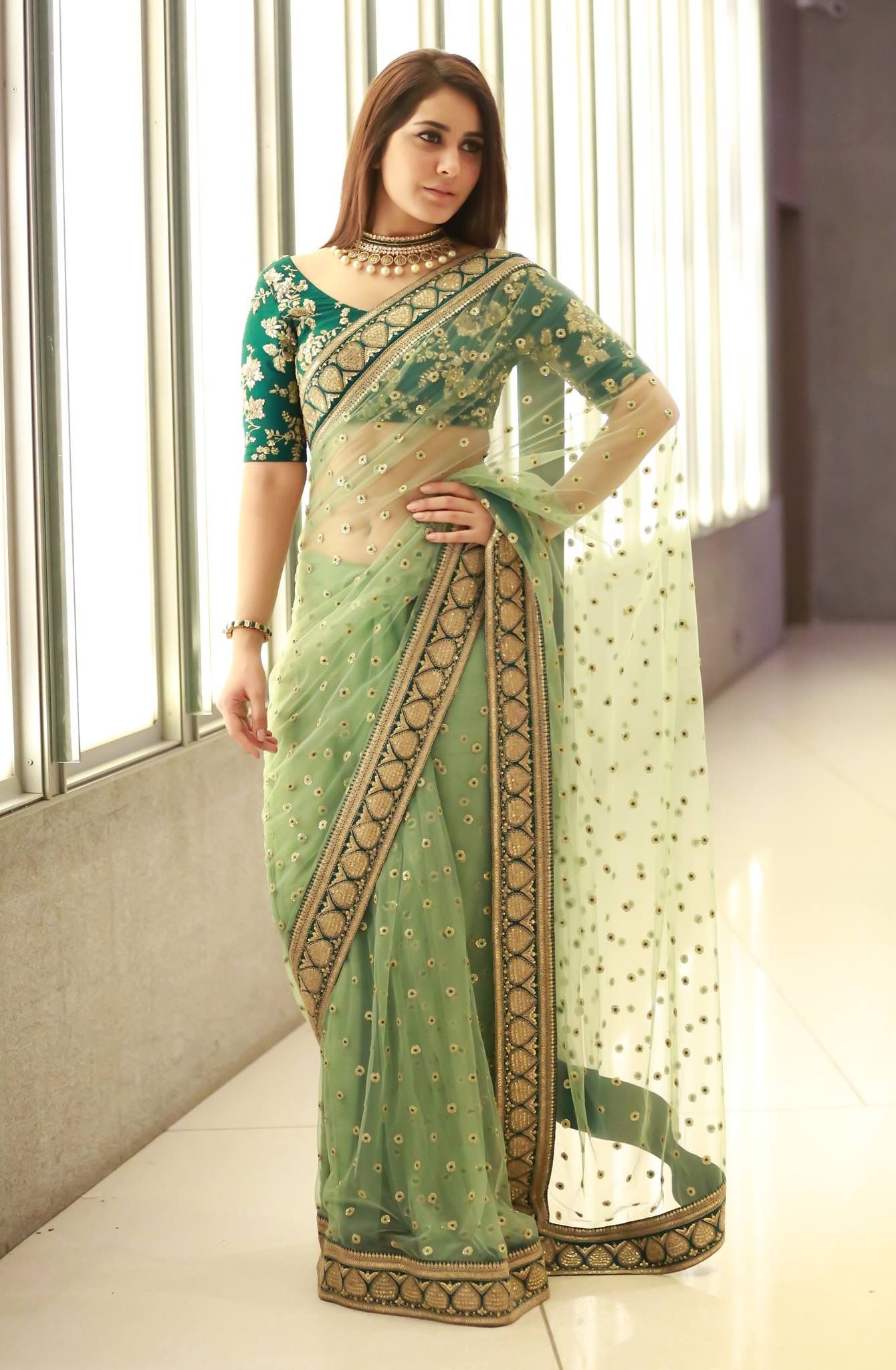 Green-Color-Designer-Net-Sarees-With-Booties-&-Border-Work