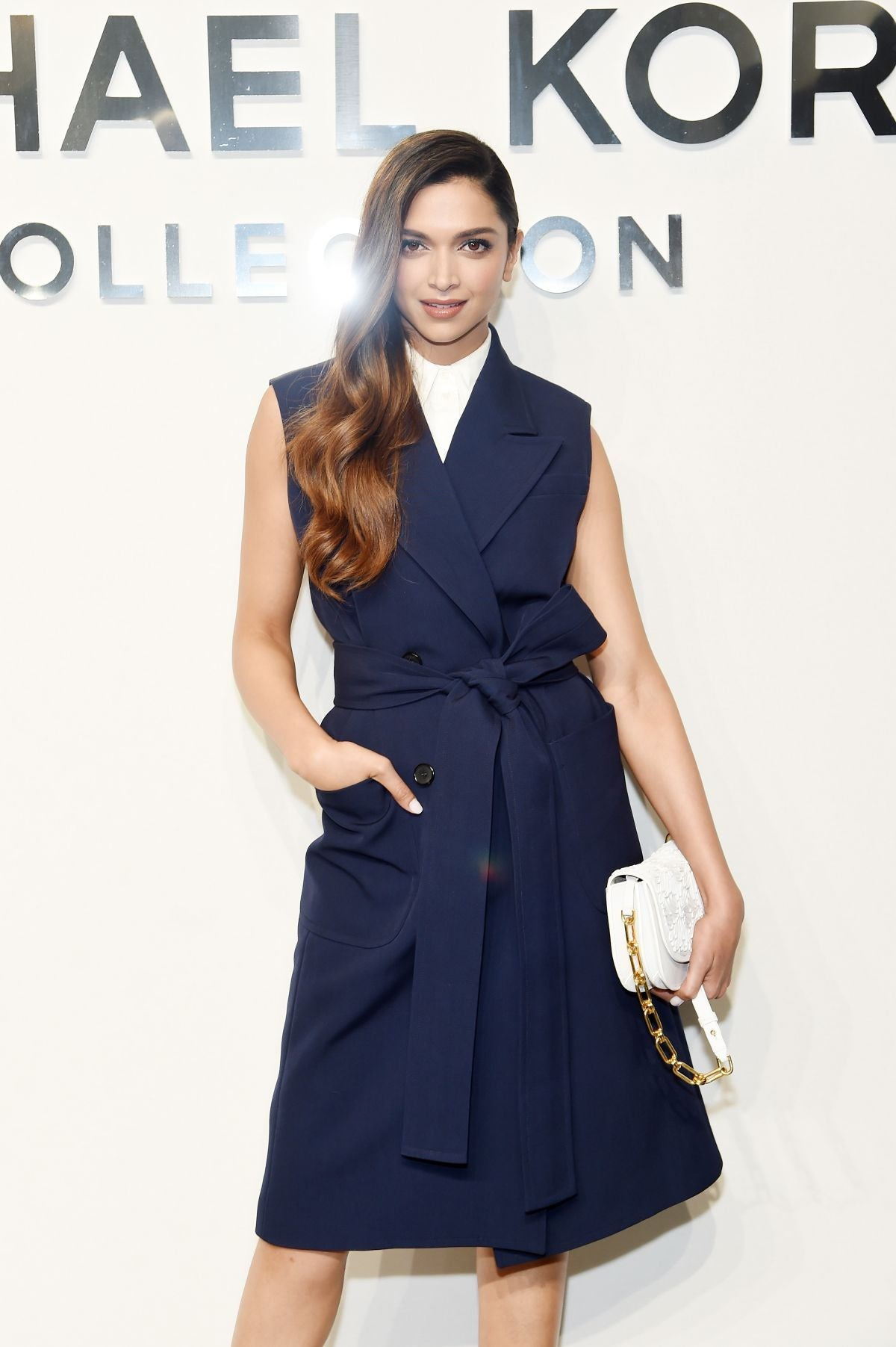Deepika Padukone in Michael Kors Spring 2017 collection navy blue trench dress at new york fashion week