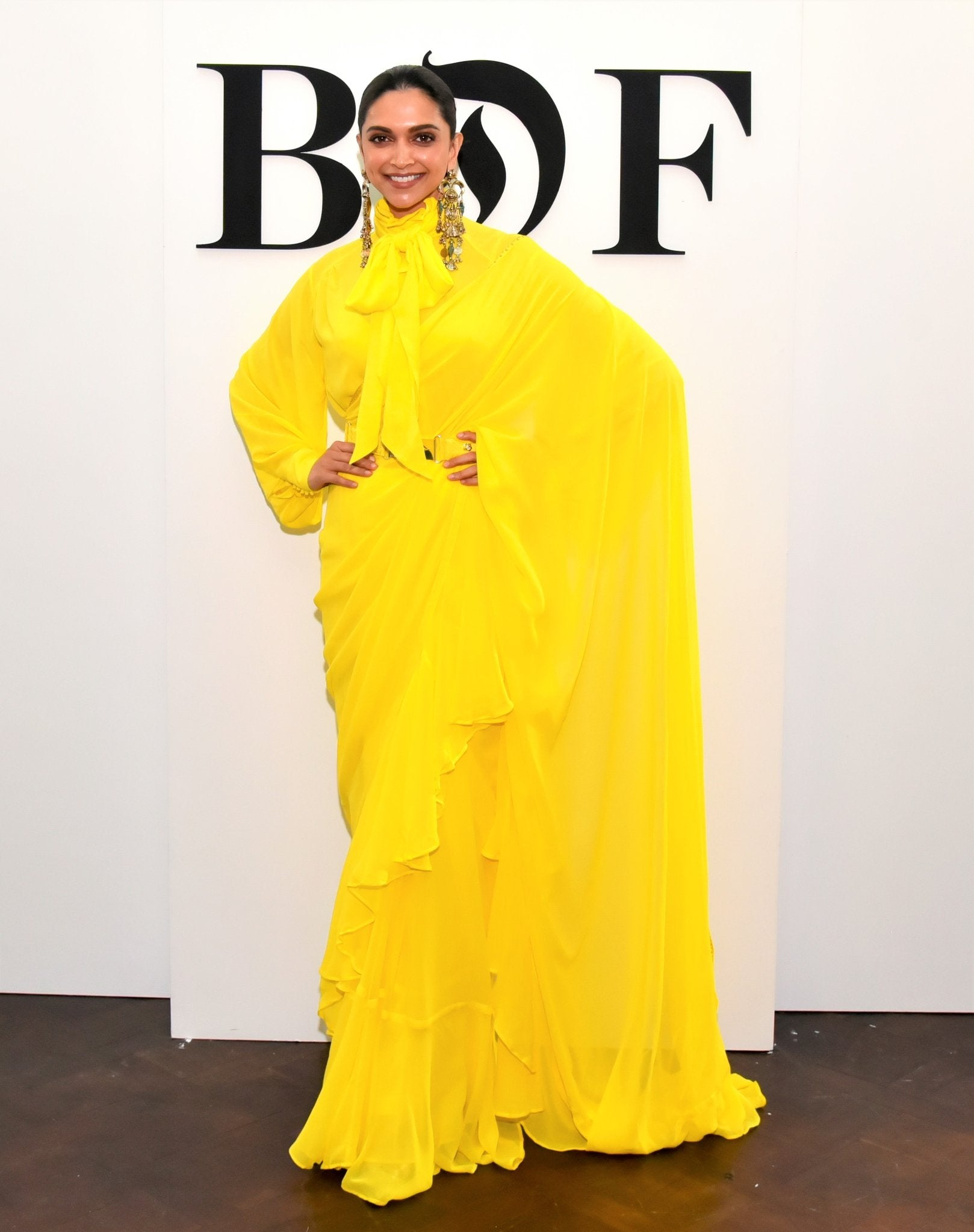 Deepika-padukone-in-palin-yellow-Ruffle Sarees