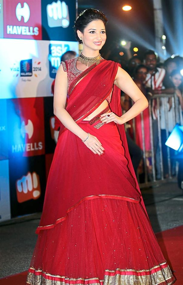 79d3e993e5 Tamanna Bhatia in red saree. She is looking surprisingly beautiful in this  red saree.