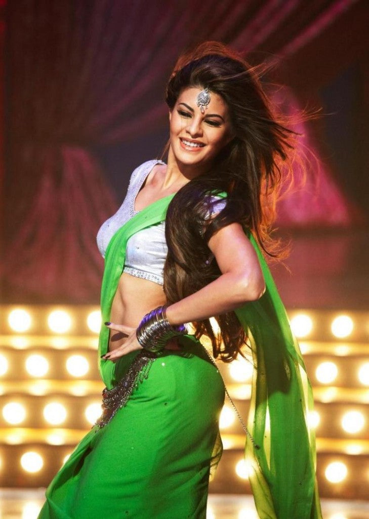 def4b616f6 Jacqueline Fernandez in Saree in Housefull 2. Jacqueline is seen shaking  her legs for a dance number from her movie Housefull 2. The green saree  just made ...