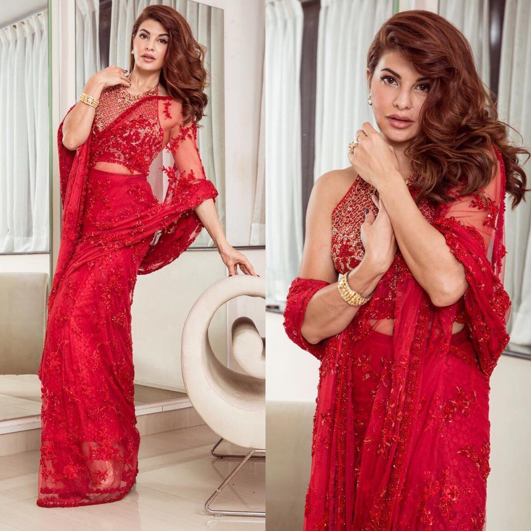 Jacqueline Fernandez fabulous in a bright red netted embroidery saree from Faraz Manan,paired with a embroidery backless blouse
