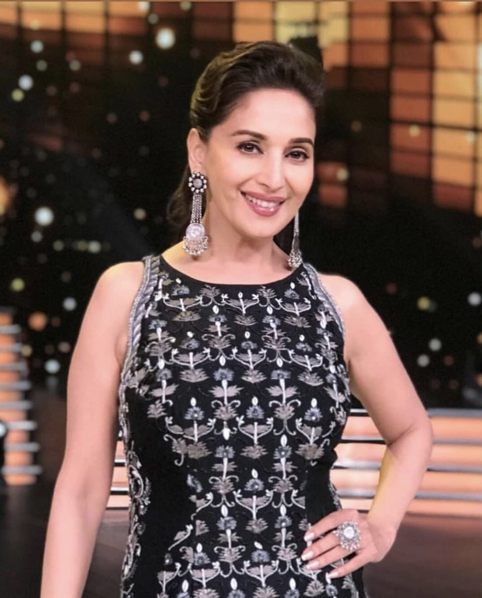 Madhuri-Dixit-in-black-and-white-embroidered-long-tunic-with-a-black-skirt