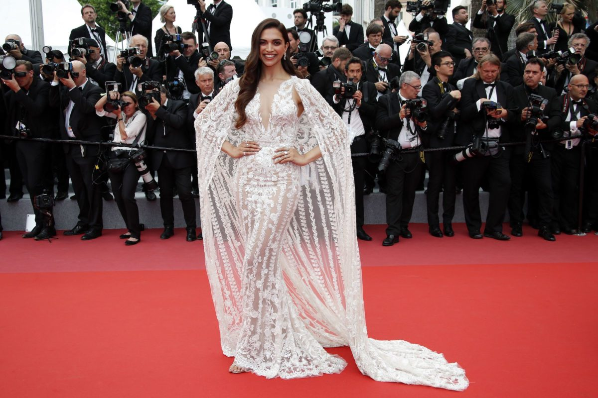 Deepika Padukone in White Plunging Neckline Sheer Gown from Zuhair Murad's Collection at Cannes Film Festival