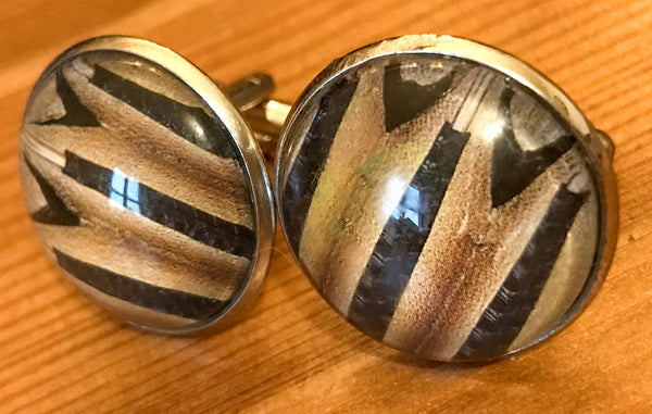 Cufflinks, featuring accordion bellows
