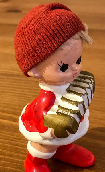 Figurine of Child Playing Concertina - TheReedLounge.com