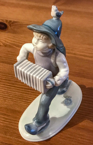 Metzler and Ortloff German vintage figurine of a young boy playing an accordion - TheReedLounge.com
