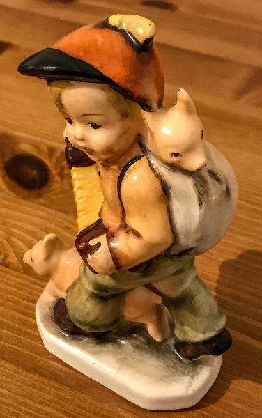 Porcelain figurine of a boy playing concertina
