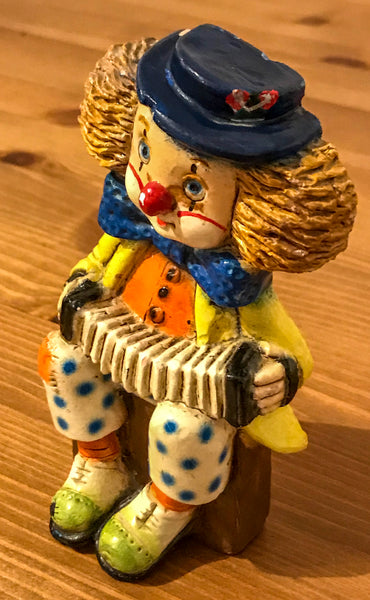 Wall plaque of a clown playing concertina - TheReedLounge.com