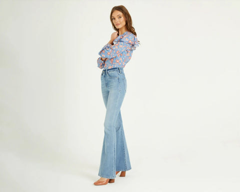 woman wearing flare jeans for fall by dear john from 308 boutique
