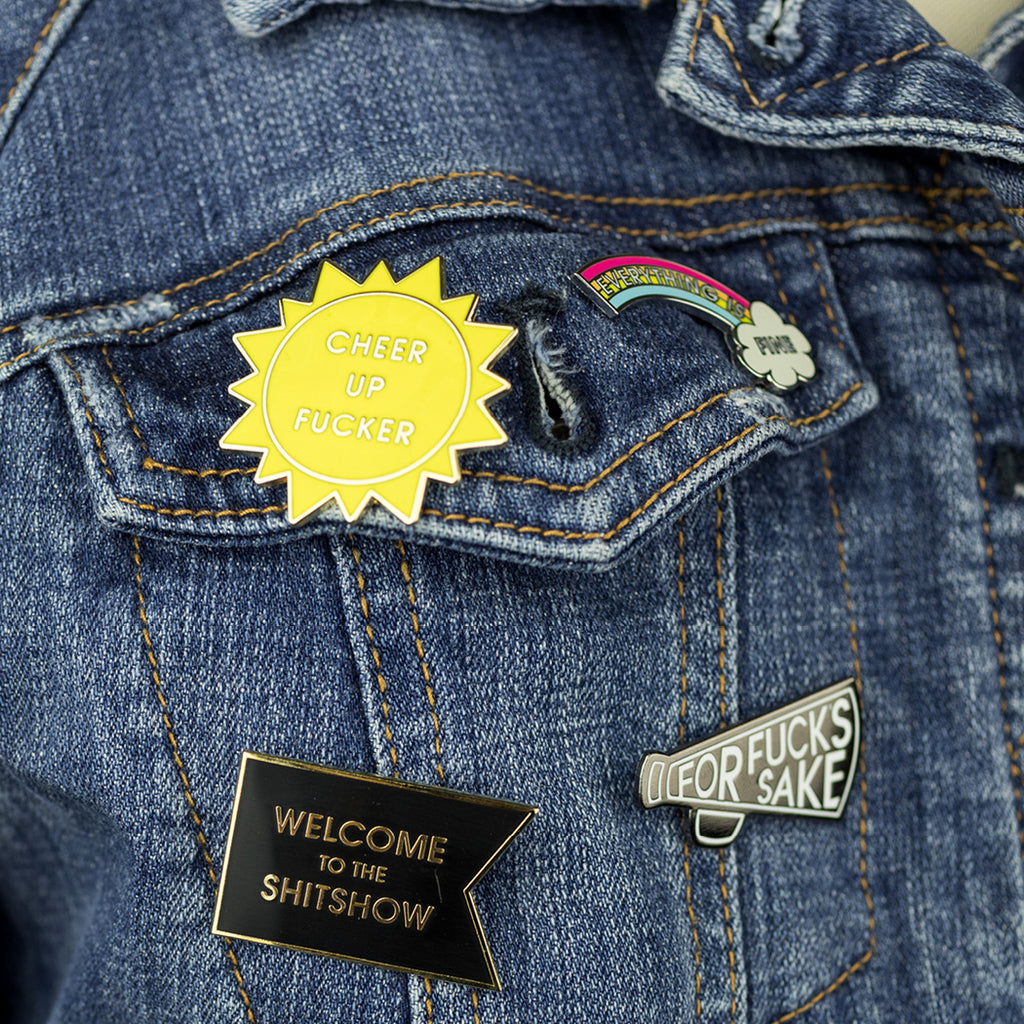 "Say it loud, say it proud - Welcome to the Shitshow! 1.5"" Hard Enamel Pin  This hilarious and relatable enamel pin is mounted to a pink and foil patterned Card Backer. The perfect enamel pin for COVID. Ideal for your denim jacket, face mask or backpack! Packaged in Sealed Cello"