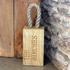 personalised oak door stop with rope handle.