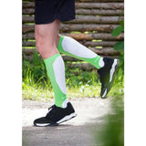Man running with comfortable green compression socks