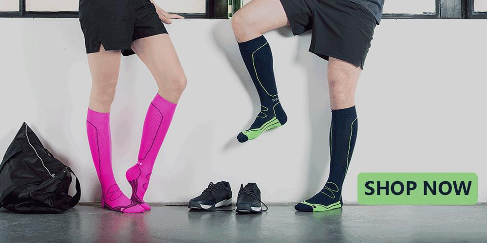 Pink running compression socks and navy blue compression socks. Shop Now. Free Delivery.
