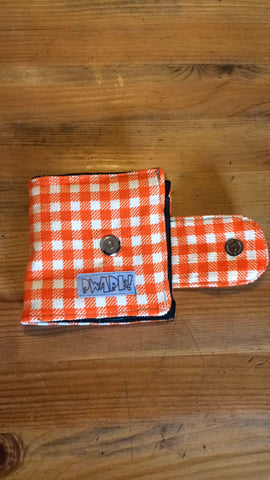 white/orange wallet