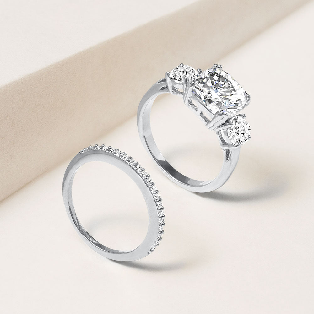 """Yes, I Do"" 5.2CTW 3 Stone Cushion Cut & Eternity Band Ring Set - Silver"