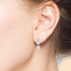 """Dazzling Trio"" 2.7CTW Graduated 3 Round Cut Stones Drop Earrings - Silver"