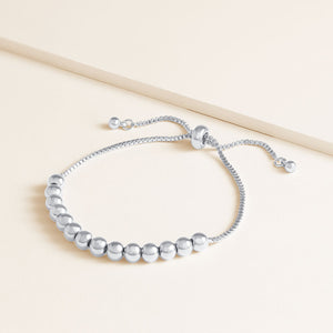"""Mine Definitely"" Highly Polished Beaded Pull-Tie Bracelet"