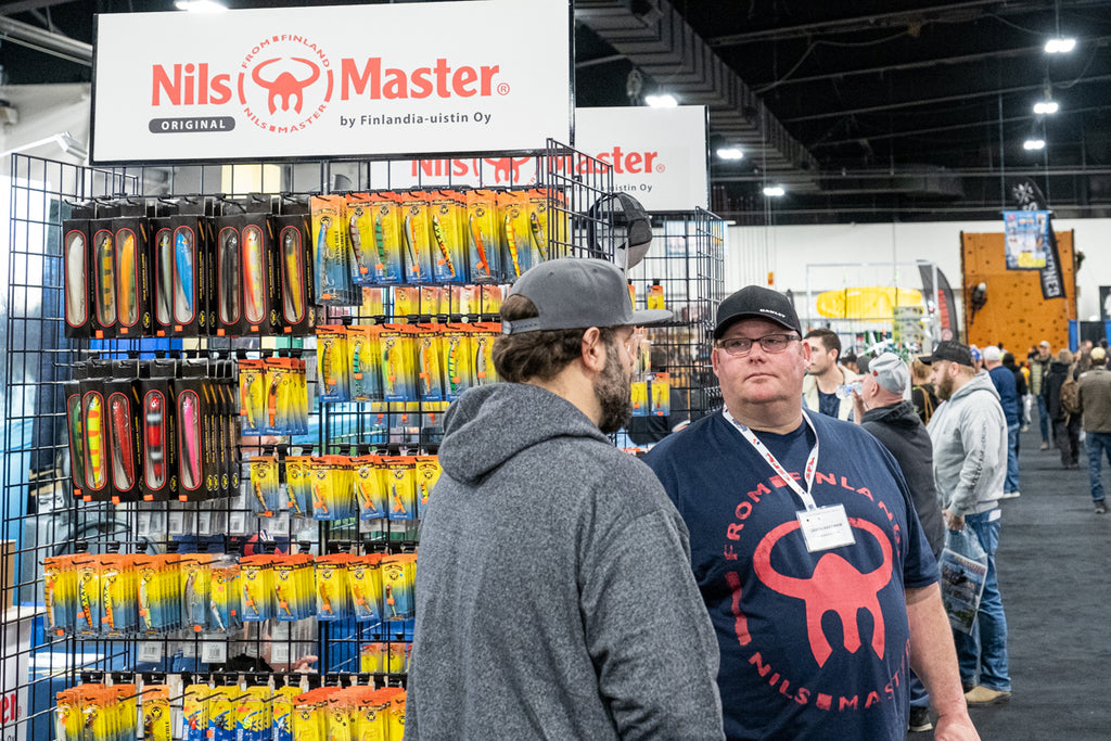 Talking to customer at the Spring Fishing & Boat Show Toronto 2020