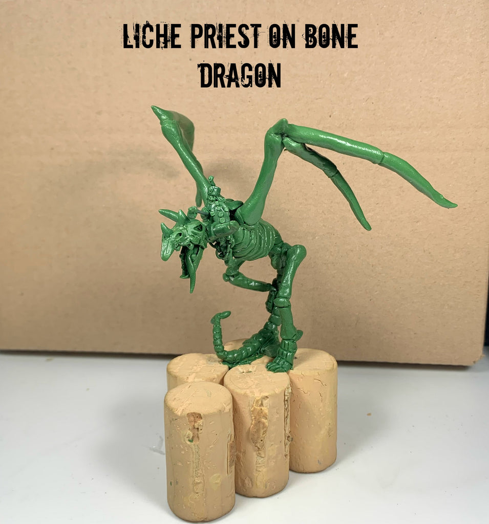liche priest on bone dragon