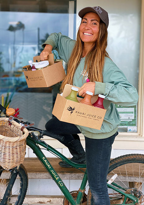 Woman delivering juice on a bicycle