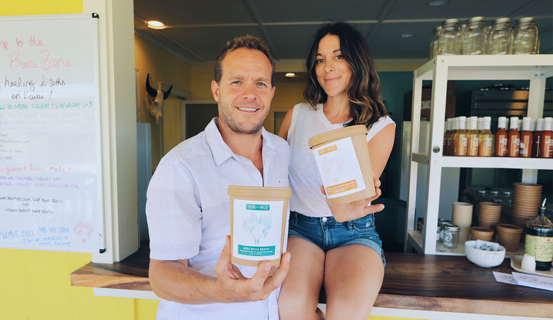 Kristal and Dylan Muhich holding cups of bone broth