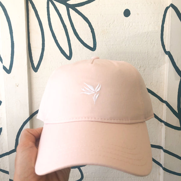 pink dad hat with bird of paradise embroidered on front