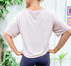 woman showing back of white short sleeve tshirt