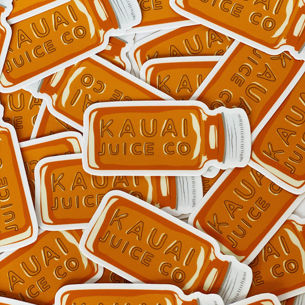 pile of orange hand drawn Kauai Juice Co jar stickers