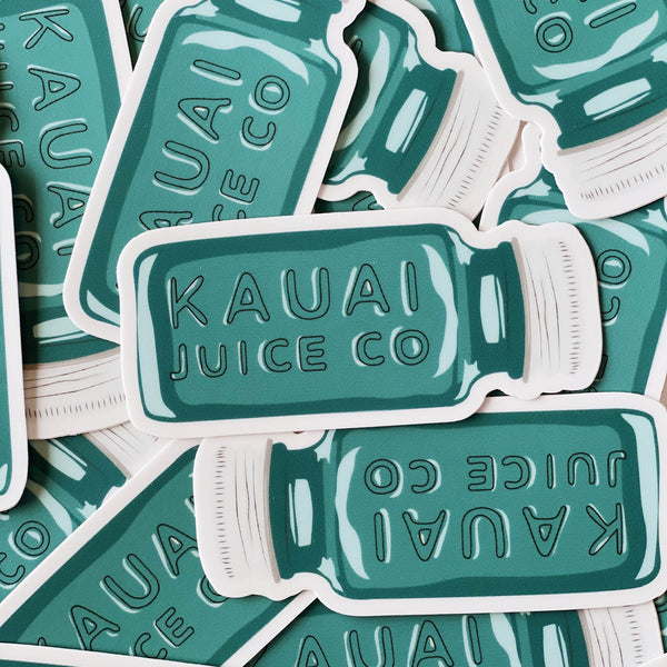 pile of hand drawn Kauai Juice Co jar stickers