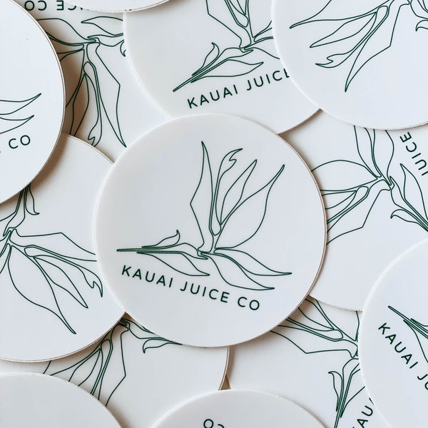 pile of white circle Kauai Juice Co bird of paradise stickers