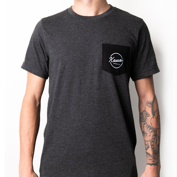 man wearing grey short sleeve tshirt with black pocket with Kauai Juice Co circle logo