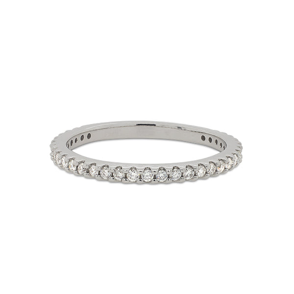 Front view of a 3/4 diamond eternity band set with round cut diamonds in a 14 kt white gold setting.