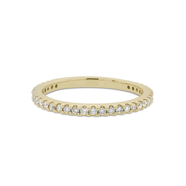 Front view of a 3/4 diamond eternity band set with round cut diamonds in a 14 kt yellow gold setting.