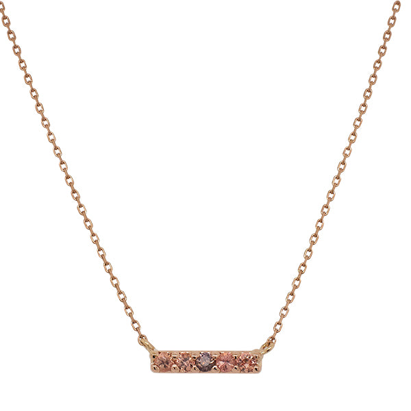 Front view of a solid 14 kt rose gold bar necklace with 5 round cut, warm colored sapphires.
