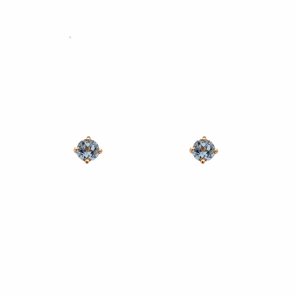Front view of 3.3 mm round cut, aquamarine studs set in 4 prong 14 kt yellow gold settings.