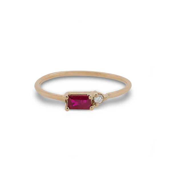 Front view of baguette cut ruby and round diamond ring cast in 14 kt yellow gold.
