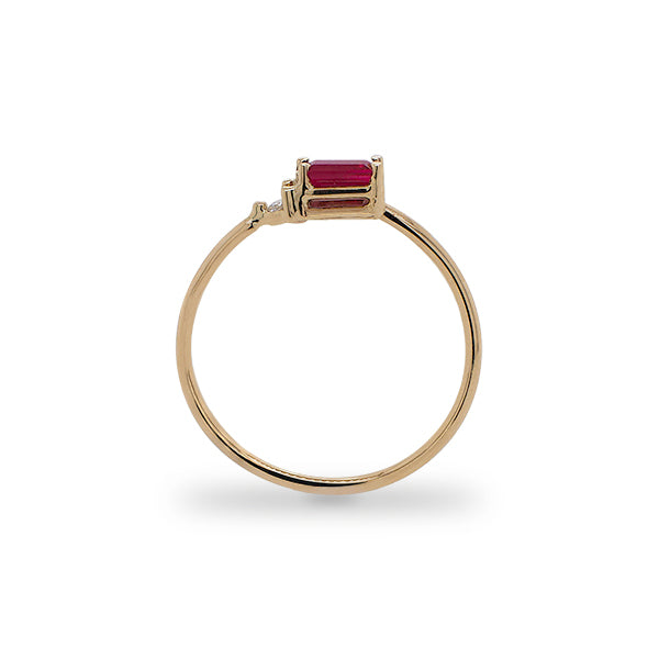 Load image into Gallery viewer, Side view of baguette cut ruby and round diamond ring cast in 14 kt yellow gold.